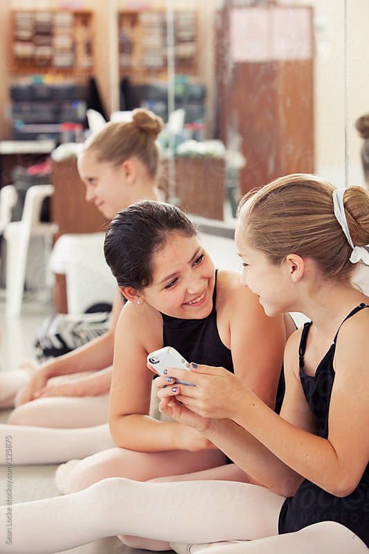 Ballet: Friend Laughs at Funny Text by Sean Locke for Stocksy United