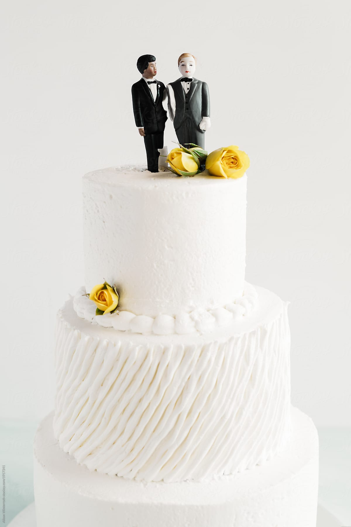Two Men Standing On Top Of A Wedding Cake Stocksy United
