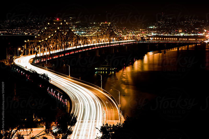 Busy bridge at night by Anna-Marie Panlilio for Stocksy United
