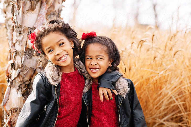 beautiful, happy sisters  by Kelly Knox for Stocksy United