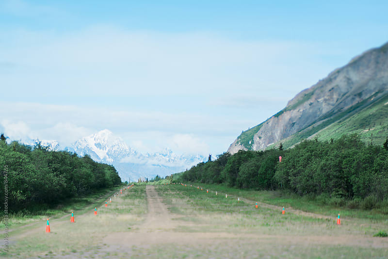 Dirt and grass runway in the mountains in Alaska by Tara Romasanta for Stocksy United