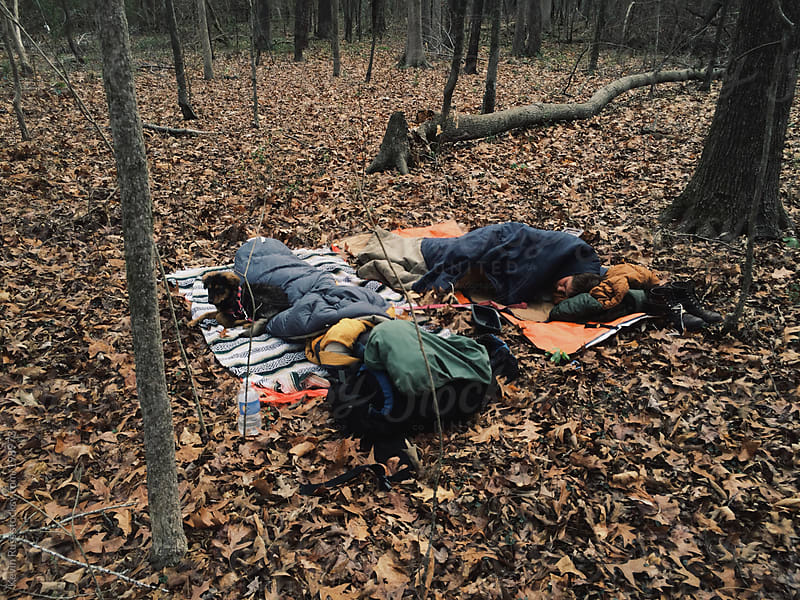 Sleeping on Leaves in the Woods by Kevin Russ for Stocksy United