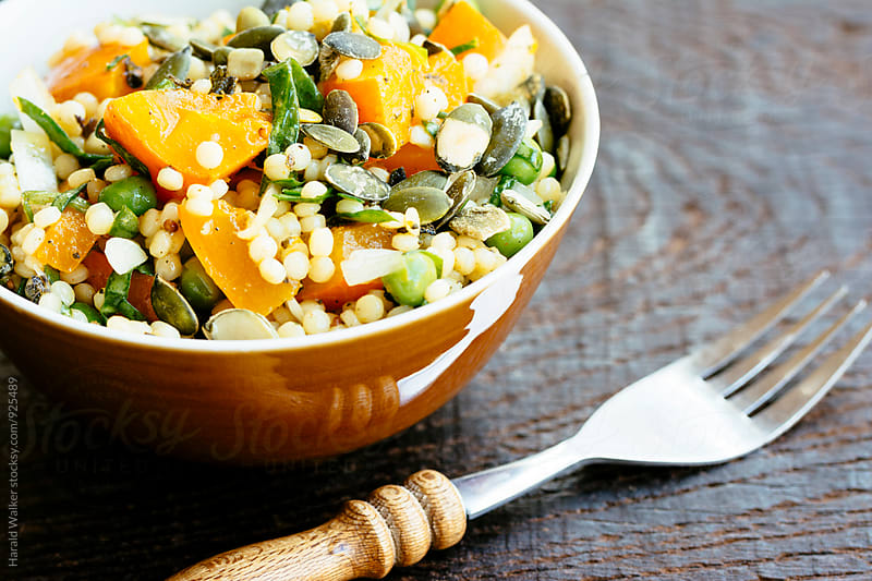 Pearl Couscous Salad with Squash, Spinach and Peas by Harald Walker for Stocksy United