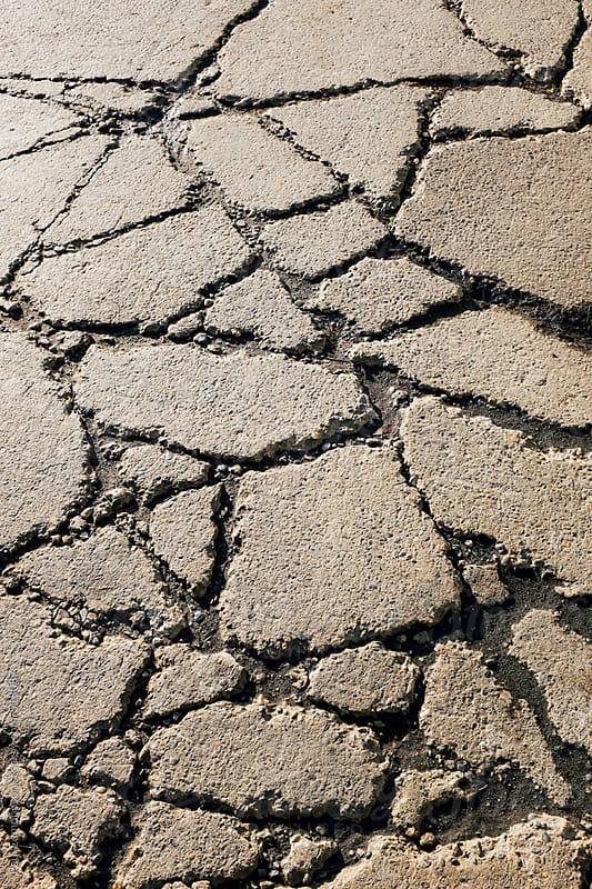 Cracks on urban street by Paul Edmondson for Stocksy United