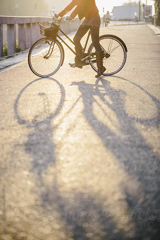 Bicycle with a long shadow by michela ravasio for Stocksy United