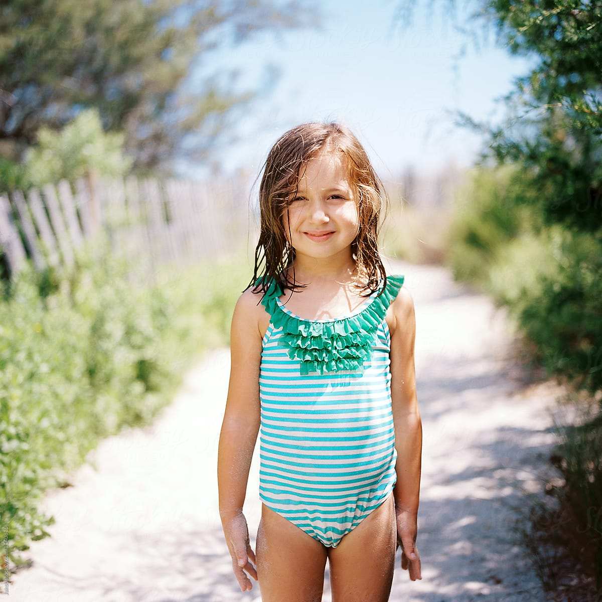 Cute Young Girl Standing By A Beach Walkway In A Bathing -7459
