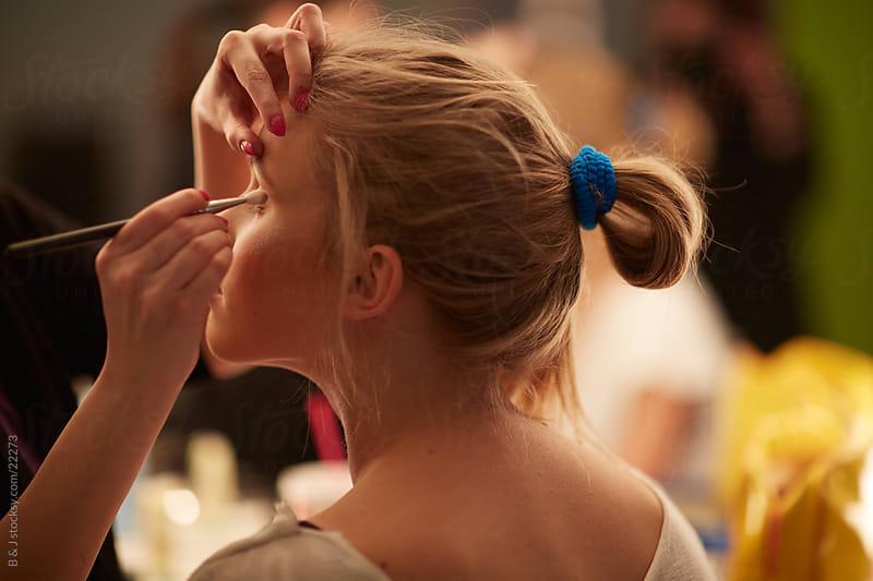 Applying Makeup by B & J for Stocksy United