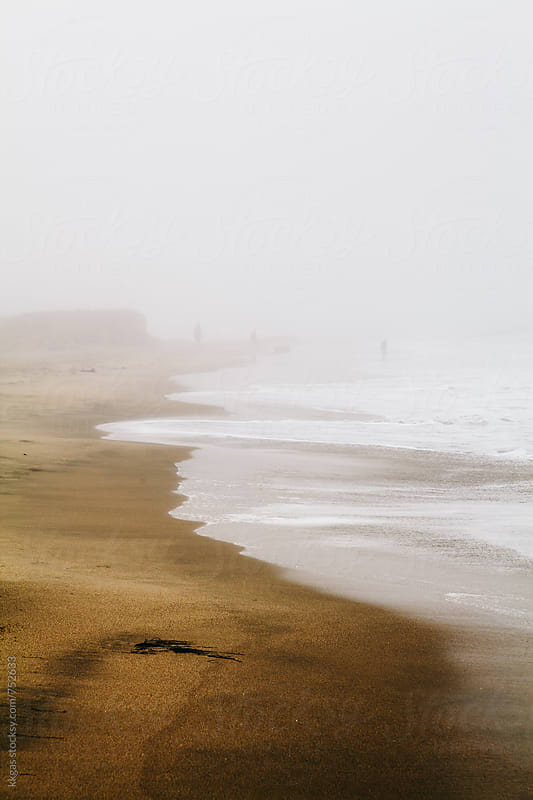 Misty waves on an empty beach. by kkgas for Stocksy United