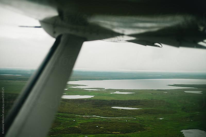 Alaskan green wet lands seen from an airplane window by Kristine Weilert for Stocksy United