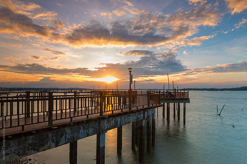 Sunset at Changi coastal boardwalk by Jacobs Chong for Stocksy United