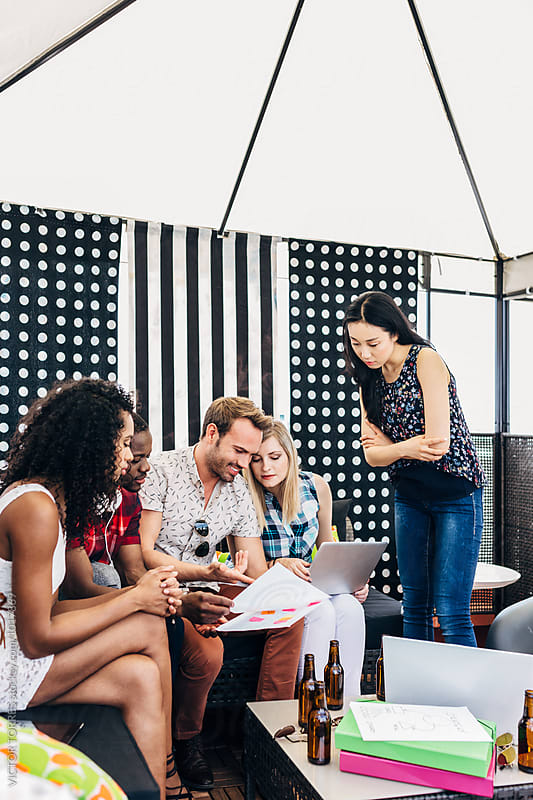 Coworking Outdoor Office with Young Entrepreneurs by VICTOR TORRES for Stocksy United