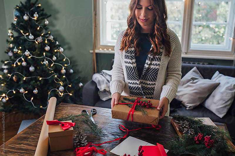 Woman Makes a Christmas Present by Lumina for Stocksy United
