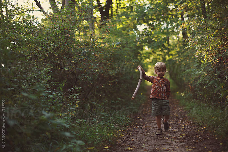 Boy With A Stick #3 by ALICIA BOCK for Stocksy United