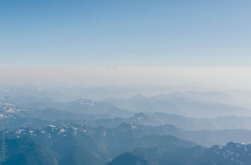 Breathtaking aerial view on mountains in fog by Trent Lanz for Stocksy United