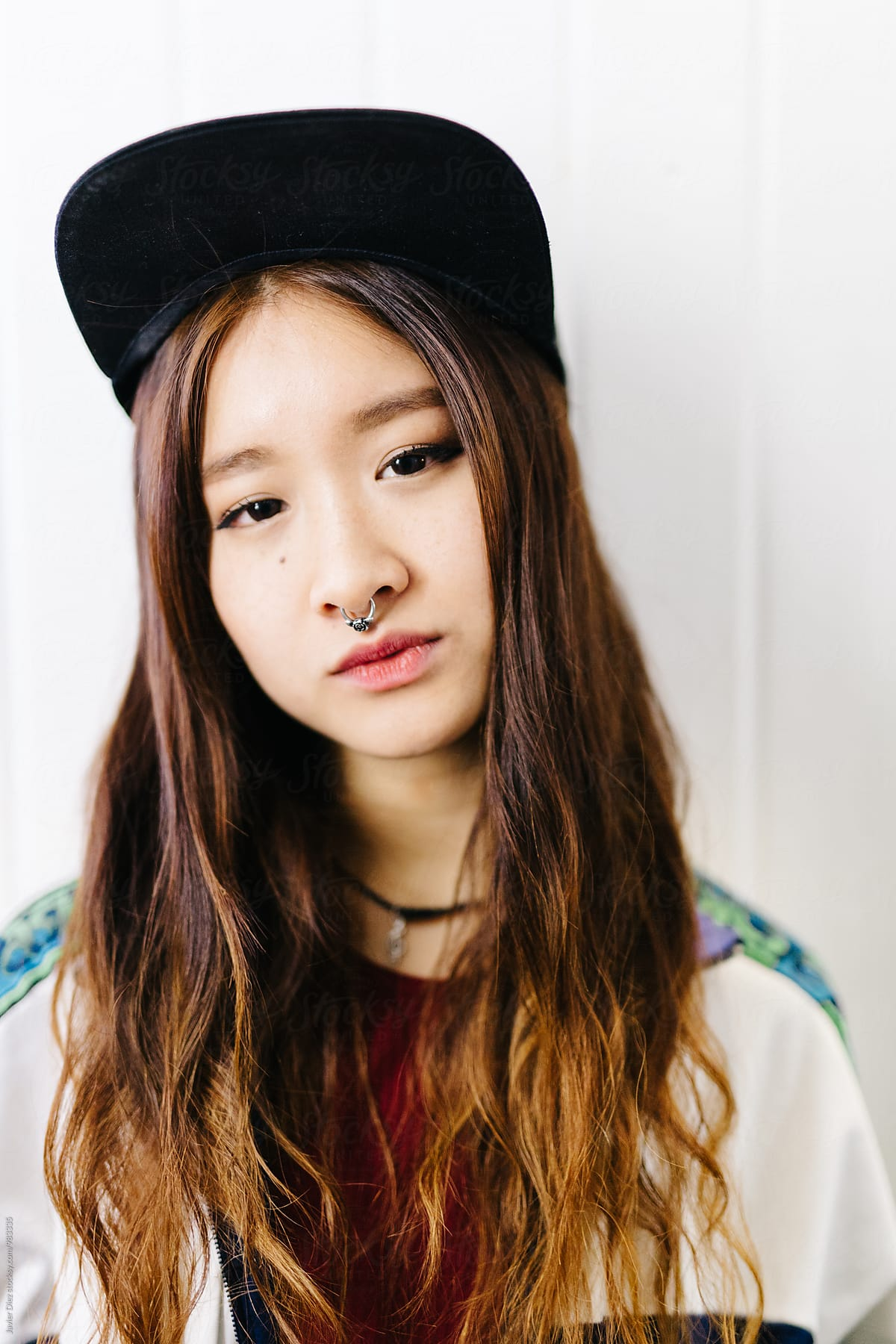 Asian Girl With Septum In Cap Looking At Camera  Stocksy -8960