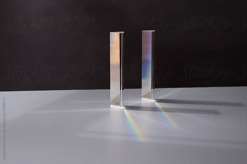Two glass prisms splitting light... by Catherine MacBride for Stocksy United