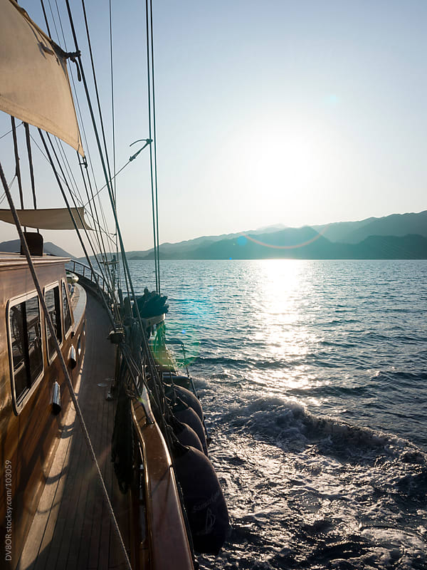 Gulet sailing into the sun on the Turkish Riviera near Dalaman by DV8OR for Stocksy United