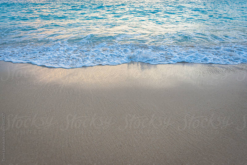 Peaceful sea waves on sandy beach by Trent Lanz for Stocksy United