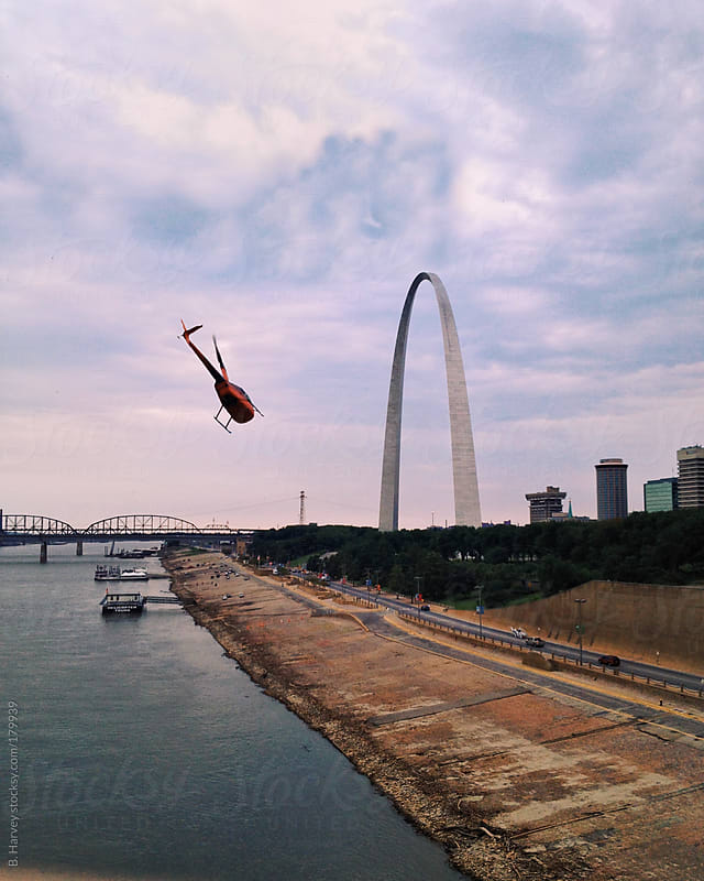 The perfect shot of the St. Louis skyline with a helicopter and the arch by B. Harvey for Stocksy United