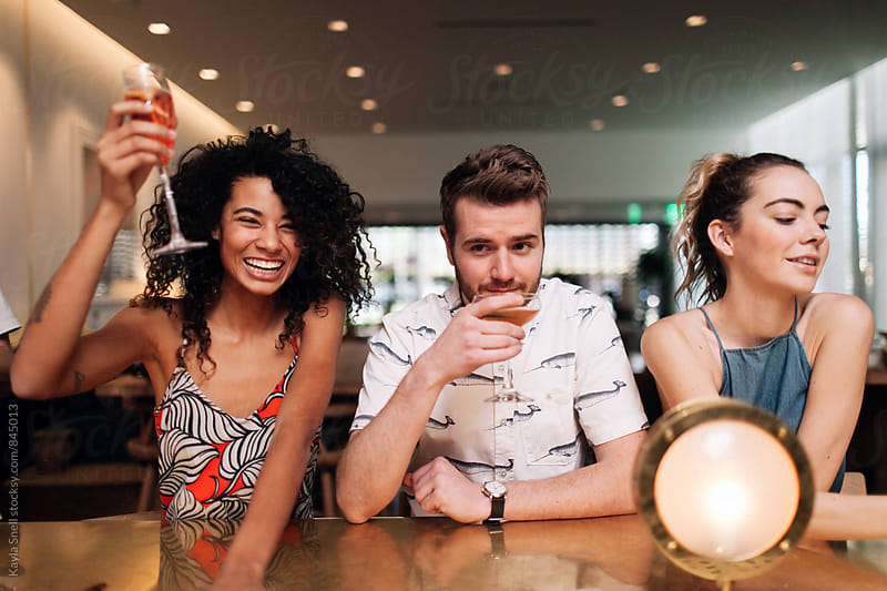 Friends at a bar by Kayla Snell for Stocksy United