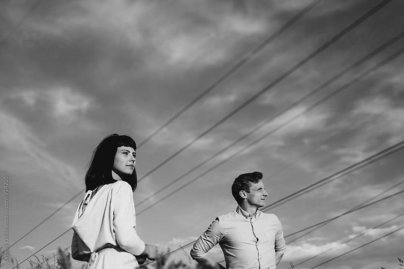 Young couple under the power lines by Evgenij Yulkin for Stocksy United