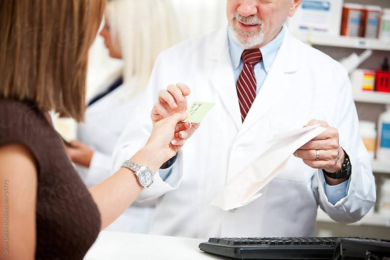 Pharmacy: Giving Pharmacist Credit Card by Sean Locke for Stocksy United