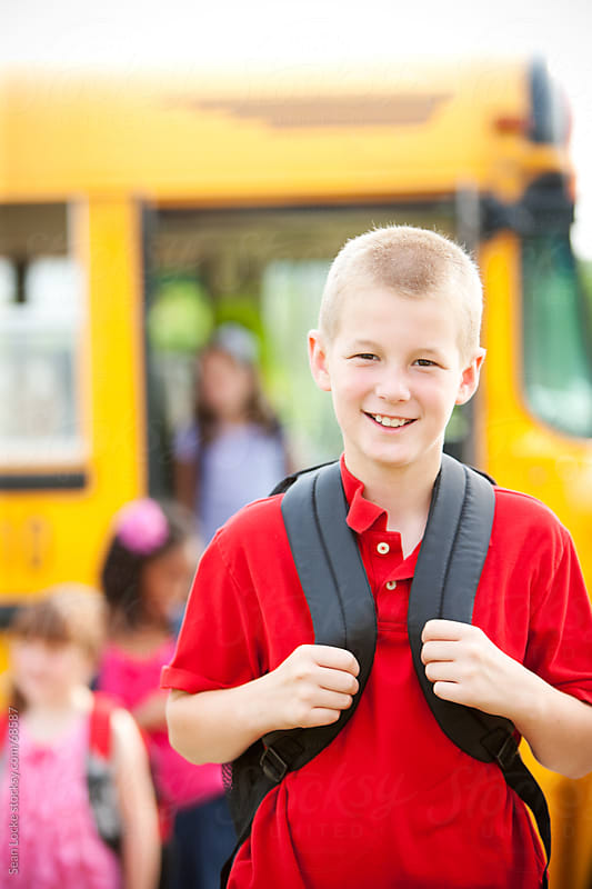 School Bus: Handsome Boy Home From School by Sean Locke for Stocksy United