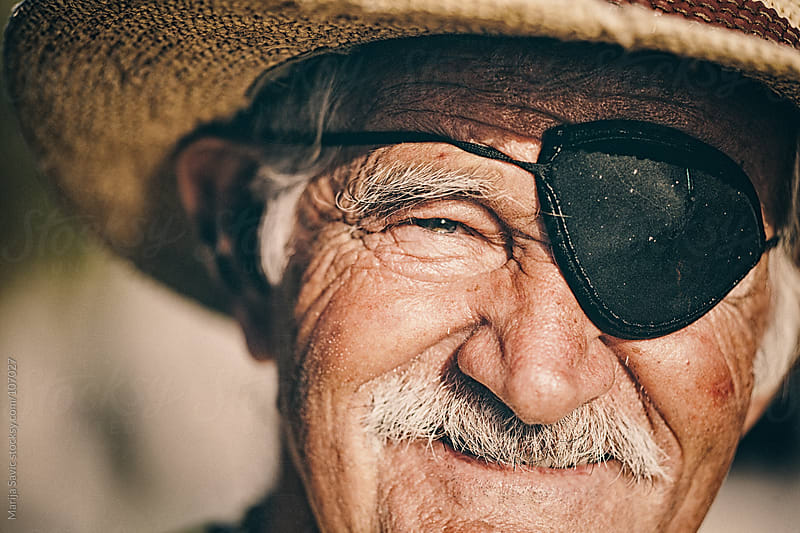 Close up of an old man with eye patch. by Marija Savic for Stocksy United