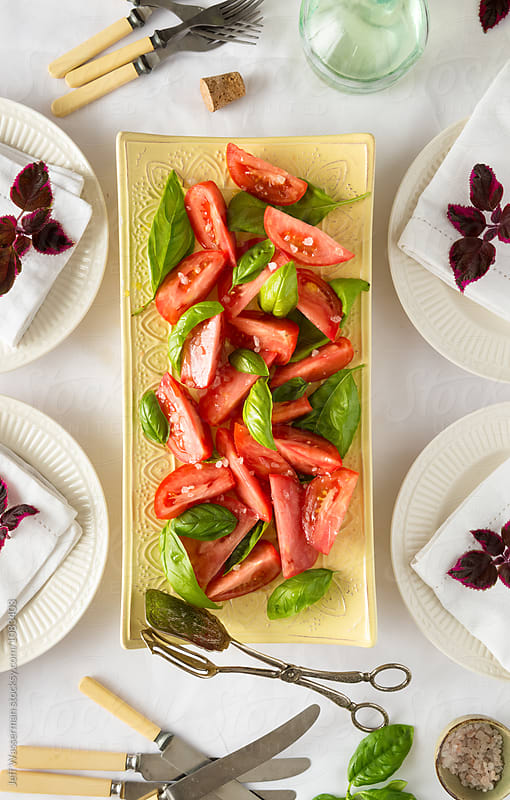 Table Set with Tomato Salad with Basil  by Jeff Wasserman for Stocksy United
