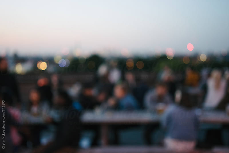 Blurred people and sunset over London by Kirstin Mckee for Stocksy United
