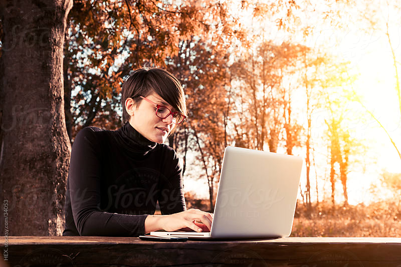 Woman Using Laptop Outdoor by HEX. for Stocksy United