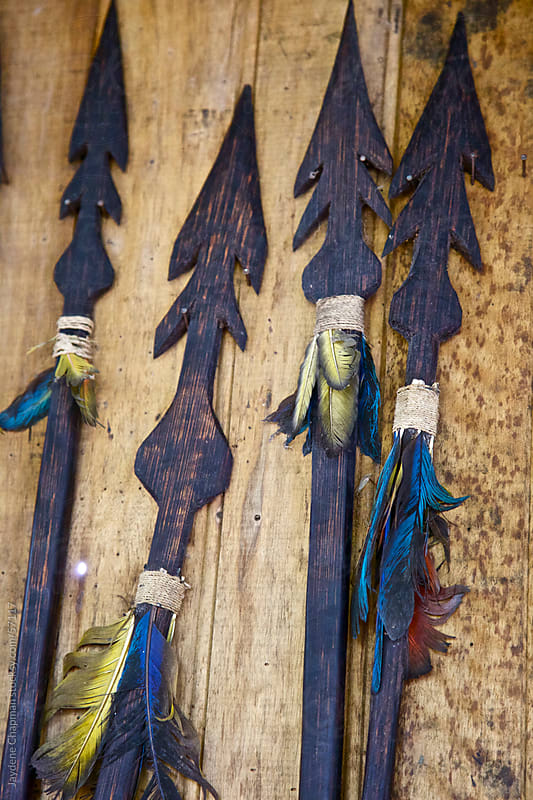Handmade jungle spears nailed to a wooden wall, Banos, Ecuador by Jaydene Chapman for Stocksy United