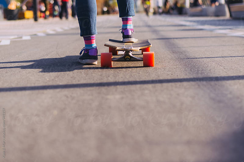 Young woman driving a longboard by Katarina Simovic for Stocksy United