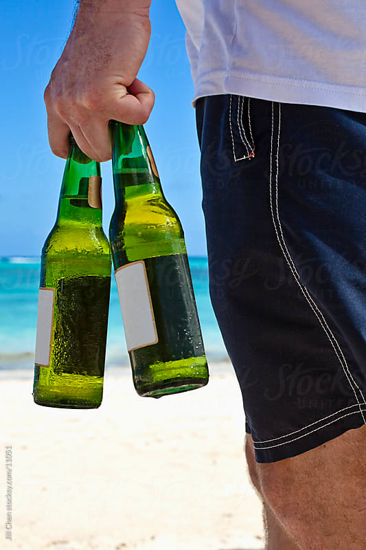 Cold Beer on Beach by Jill Chen for Stocksy United