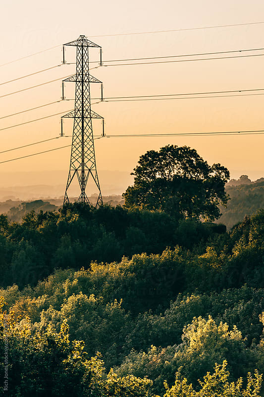 Power Lines in rural land at Sunset by Richard Jones for Stocksy United