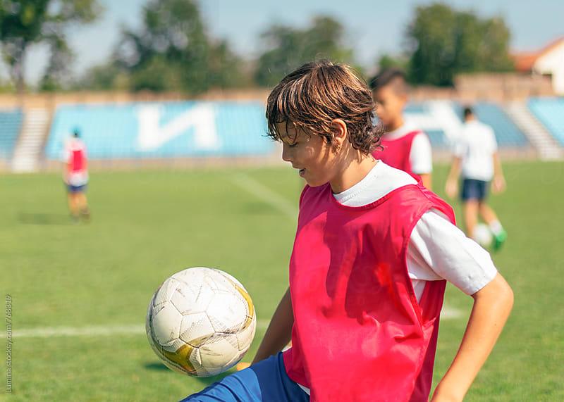 Boy Juggling a Soccer Ball by Lumina for Stocksy United