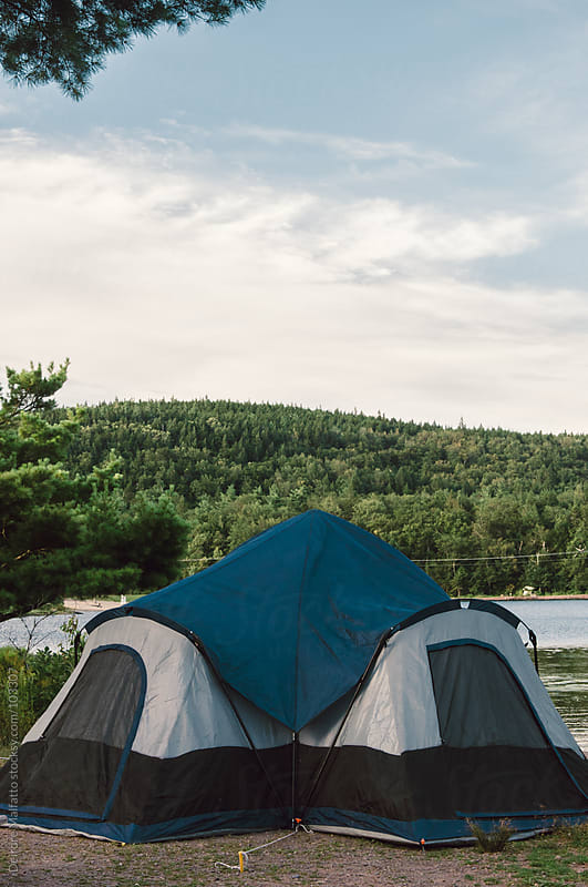tent overlooking lake at campsite by Deirdre Malfatto for Stocksy United