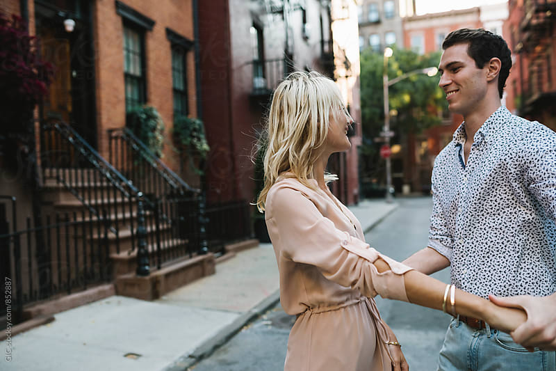 Affectionate young couple in the city by GIC for Stocksy United