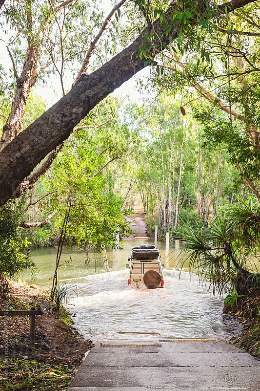 four wheel drive crossing a creek, Kakadu NP, NT, Australia by Gillian Vann for Stocksy United