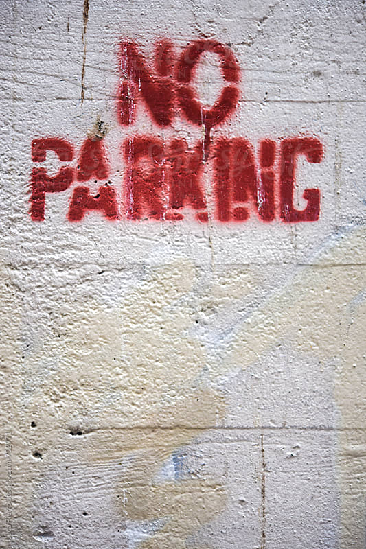 No parking sign on a wall by Luca Pierro for Stocksy United