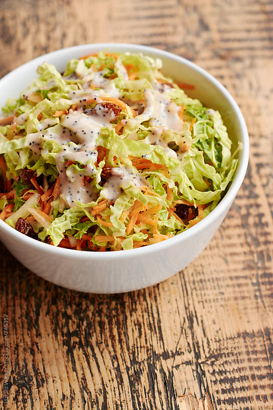 Savoy Cabbage Cole Slaw with Poppyseed Dressing by Harald Walker for Stocksy United