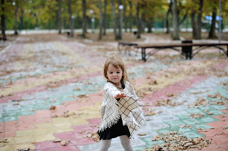 The little girl in a white poncho by Sveta SH for Stocksy United