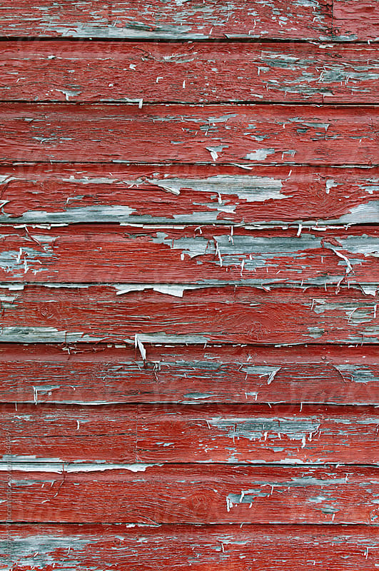 weathered red-painted wall by Margaret Vincent for Stocksy United