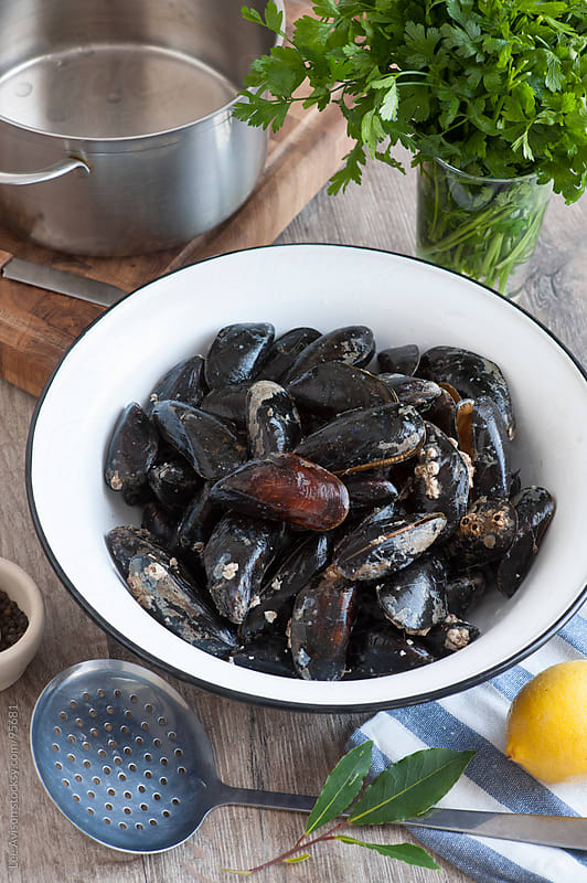 cooking mussels  by Lee Avison for Stocksy United