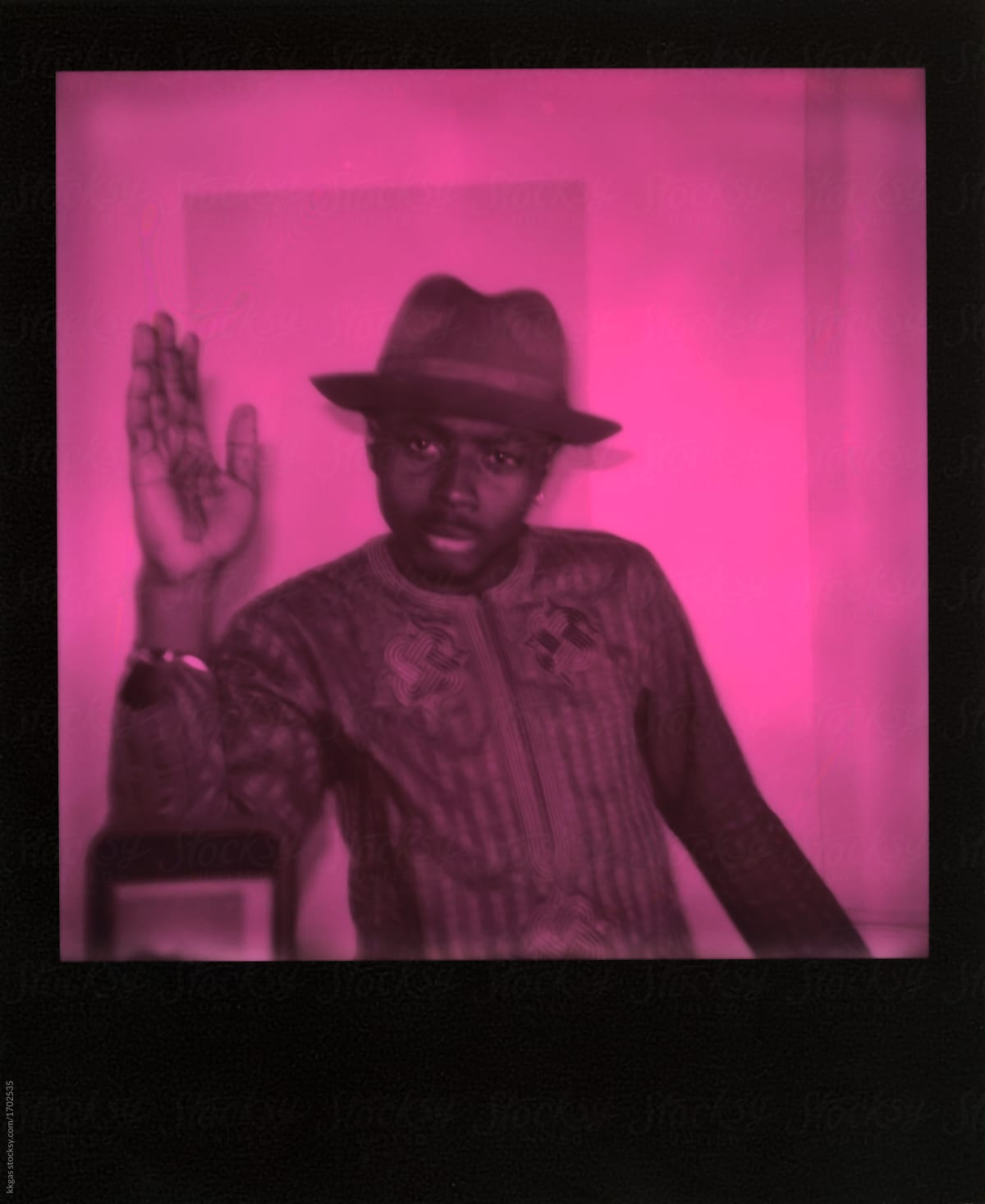 70ebe33cfa9ab Pink duochrome polaroid scan on a cool tattooed black man by kkgas for  Stocksy United