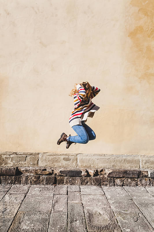 Teenage Girl Jumping on an Old Grungy Background by Giorgio Magini for Stocksy United