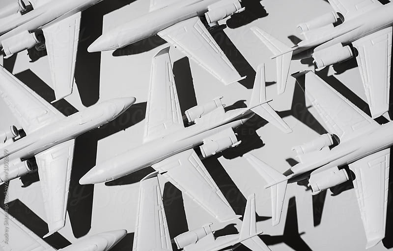 White airplane/jet formation on white background/miniature by Marko Milanovic for Stocksy United
