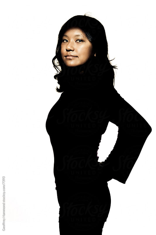 Silhouette Portrait of Young Woman by Geoffrey Hammond for Stocksy United