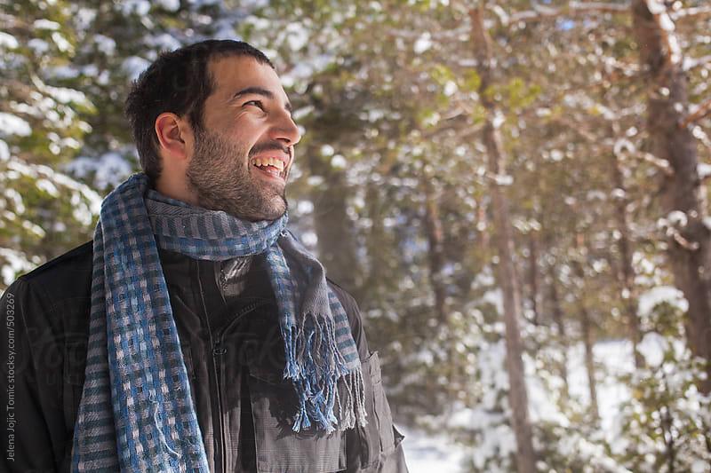 Winter portrait of a man by Jelena Jojic Tomic for Stocksy United