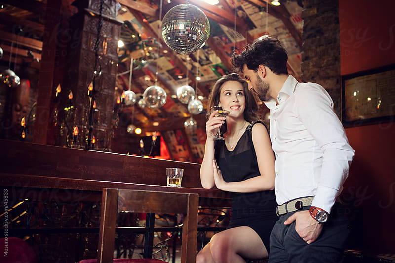 Couple in the bar. by Mosuno for Stocksy United